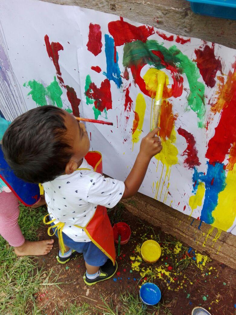 Fun Outside Painting at LittleHill Preschool